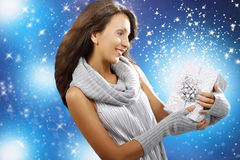 Young girl with shiny gift on xmas Royalty Free Stock Photos