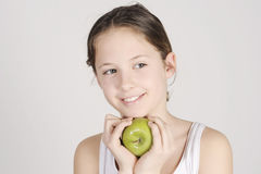 Young girl with a shiny green apple Stock Photography