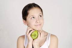 Young girl with a shiny green apple Royalty Free Stock Photography