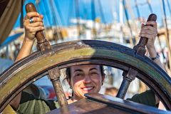 Young girl beside a ship steering Royalty Free Stock Photo