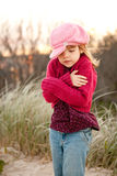 Young Girl Shivering In The Countryside Royalty Free Stock Photos