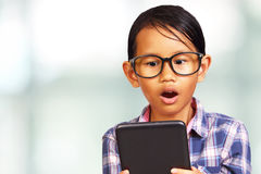 Young Girl Shocked Looking Her Tablet Royalty Free Stock Photos