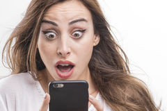 Young girl shocked looking at mobile Royalty Free Stock Photo