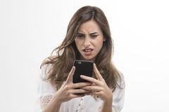 Young girl shocked looking at mobile Stock Images
