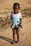 Young girl with a shoes in her hands in Mopti Stock Image