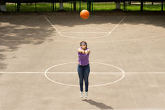 Young girl shooting a basketball Royalty Free Stock Photo