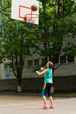 Young girl shooting a goal in basketball Royalty Free Stock Photo