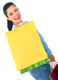 Young Girl Shopping. Beautiful young woman carrying shopping bags. isolated stock photography