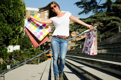 Young girl shopping. Attractive young girl with shopping bags in the street Royalty Free Stock Photos