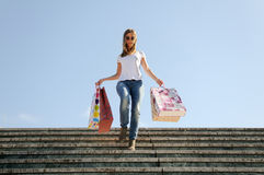 Young girl shopping. Attractive young girl with shopping bags in the street Stock Photos
