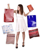 Young girl with shopping bag. Isolated. Royalty Free Stock Photography