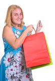 Young girl with shopping bags and credit card Royalty Free Stock Photos