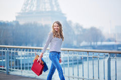 Young girl with shopping bags near the Eiffel tower stock image