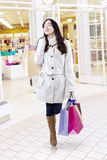 Young girl with shopping bags at shopping center Royalty Free Stock Images