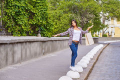 Young girl with shopping bags after shopping in the city royalty free stock photography