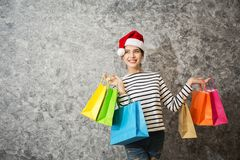 Young girl shopping on christmas day or xmas sale time. Stock Photography