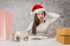 Young girl shopping on christmas day or xmas sale time. Royalty Free Stock Photography