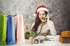 Young girl shopping on christmas day or xmas sale time. Royalty Free Stock Image