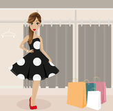 Young Girl Shopping Elegant Dress. Beautiful young woman shopping elegant dress Royalty Free Stock Images