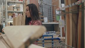 Young girl shopping in hardware store. Beautiful girl shopping in hardware store stock video footage