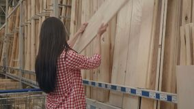 Young girl shopping in hardware store. Beautiful girl shopping in hardware store stock video