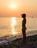 Young girl on shore sea Stock Photos