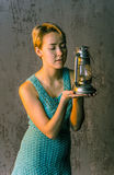 Young girl with short hair in a summer dress and old lamp Royalty Free Stock Images