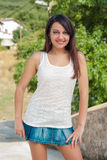 Young girl in short skirt in the sun Royalty Free Stock Image
