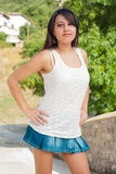 Young girl in short skirt in the sun Stock Image