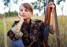 Young girl with a shotgun in an outdoor Stock Photos