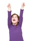 Young girl shouting with arms raised Stock Photo