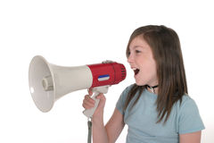 Young Girl Shouting Through Megaphone 1. Young girl or tween girl shouting, speaking, or singing through a megaphone. Shot on white Stock Image