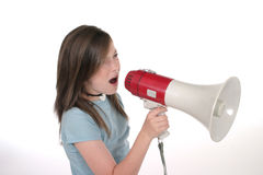 Young Girl Shouting Through Megaphone 2. Young child or tween girl shouting, speaking, or singing through a megaphone. Shot on white Stock Photos