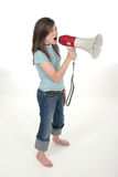 Young Girl Shouting Through Megaphone 3. Young child or tween girl shouting, speaking, or singing through a megaphone. Shot on white royalty free stock image