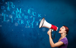 Young girl shouting into megaphone and text come out Stock Image