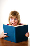 Young girl shouting over book Royalty Free Stock Image