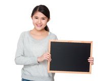 Young girl show with chalkboard Stock Photography