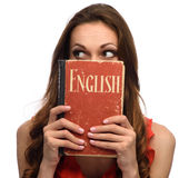 Young girl show an English textbook. Isolated on white Royalty Free Stock Photography
