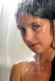 Young girl in the shower. Young girl taking a shower in natural light Stock Image