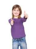 Young girl showing approval with thumbs up. Close up portrait of a cute young girl showing approval with thumbs up hand gesture stock image
