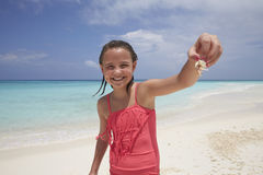 Young girl showing a crab shes collected on the beach Royalty Free Stock Photography