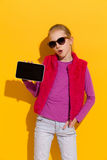Young girl showing a digital tablet. Stock Photos