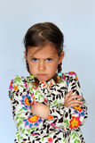 Young girl showing disapproval. Studio portrait of young girl pulling a face to show disapproval Stock Image