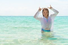 The young girl showing fingers doing Goat sign. Freedom and travel concept stock photography