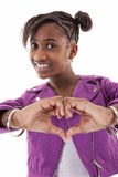 Young girl showing heart sign with hand Stock Images