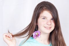 Young girl showing her earring Royalty Free Stock Images