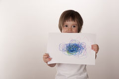 Young girl showing off artwork Stock Photo