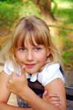 Young girl showing OK sign. Portrait of young blonde girl showing OK sign Royalty Free Stock Image