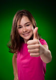Young girl showing OK sign Stock Photos