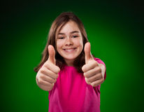 Young girl showing OK sign Stock Photography